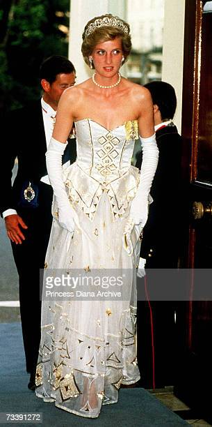 The Princess of Wales arriving at the German Embassy in London for a banquet to mark the visit or the German President, July 1986. She is wearing a...