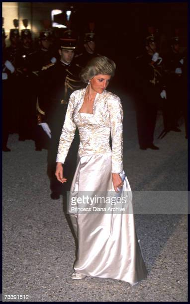 The Princess of Wales arriving for dinner at the Elysee Palace, Paris, during an official visit to France, November 1988. She is wearing a cream silk...