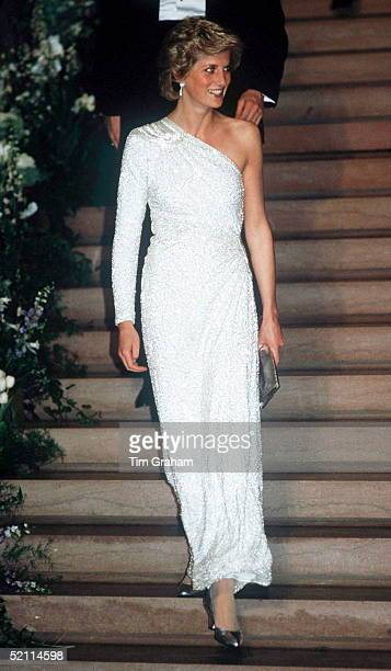 The Princess of Wales at a gala dinner at the National Gallery in Washington DC, 11th November 1985. She is wearing a white, crystal-beaded silk...