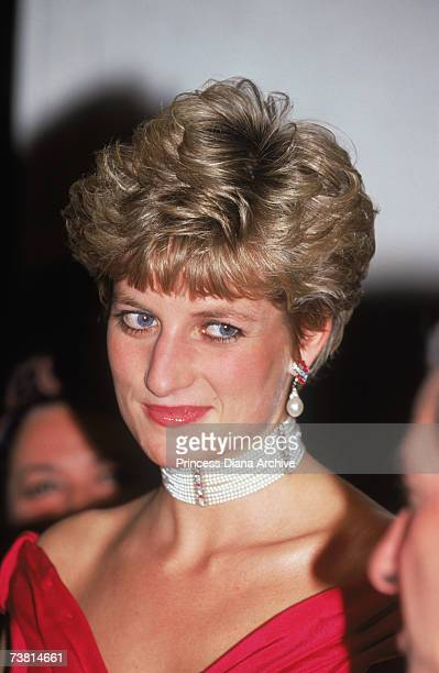 The Princess of Wales attends a performance of 'Simon Boccanegra' at the Royal Opera House in Covent Garden, 12th November 1991. She is wearing a red...