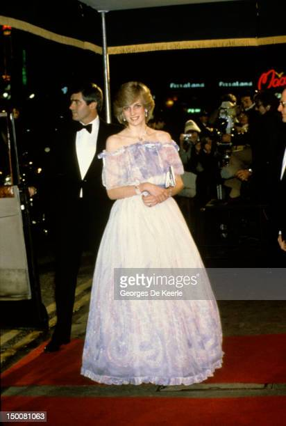 The Princess of Wales attends a Royal Variety Performance She is wearing a chiffon evening dress designed by fashion designer Bellville Sassoon