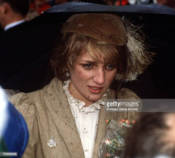 The Princess of Wales during a walkabout in the rain in Carmarthen October 1981 She wears a Caroline Charles tweed coat and a John Boyd hat