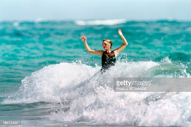 The Princess of Wales enjoys the waves at Indian Castle Beach on January 2 1993 while vacationing on Nevis AFP PHOTO PAUL J RICHARDS