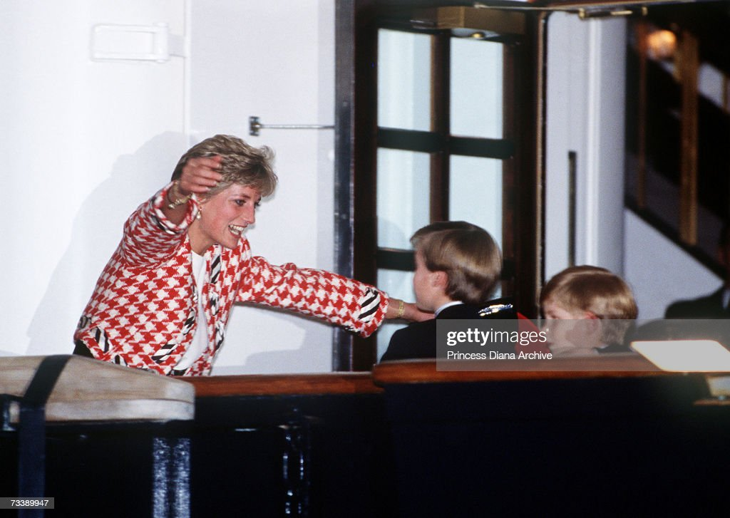 The Princess of Wales greets her sons Prince William and Prince Harry on the deck of the yacht Britannia in Toronto, when they joined their parents on an official visit to Canada, 23rd October 1991. The Princess is wearing a Moschino suit.