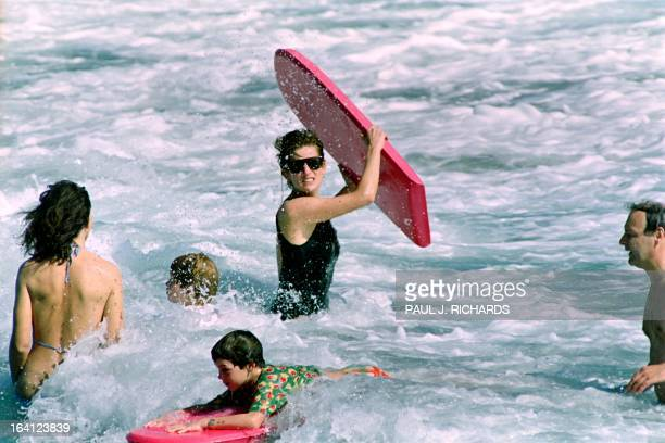The Princess of Wales heads out into the surf as her sons William and Harry and Lady Catherine Soames enjoy the waters of Indian Castle Beach on...