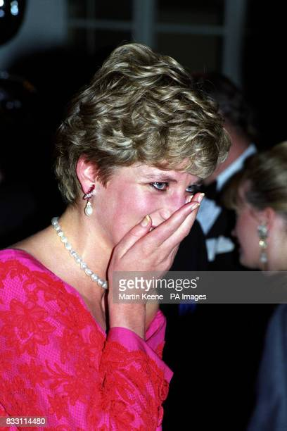 The Princess of Wales hides a giggle whilst at the London's Royal School of Music after she and her two sons Prince William and Prince Harry attended...