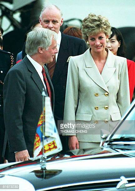 The Princess of Wales makes a face in the direction of the media covering her arrival in Hong Kong 21 April after Hong Kong Governor Chris Patten...