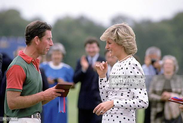 The Princess Of Wales Presents A Medal To Her Husband Prince Charles After A Polo Match At Windsor