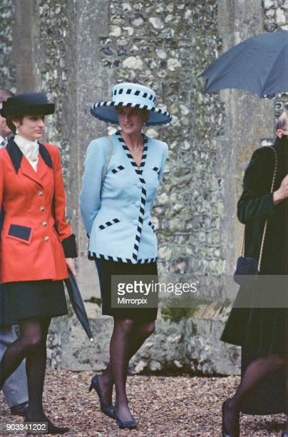 The Princess of Wales Princess Diana attends the wedding of Hon Harry Herbert son of The Queen's racing manager Lord Carnarvon at Highclere near...