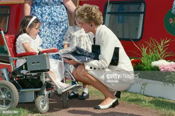The Princess of Wales, Princess Diana, during her visit to Manchester, England. She exits the red barge in the background 'Prince William' at...