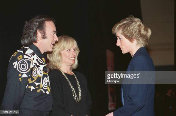 The Princess of Wales Princess Diana greets American singer Neil Diamond and his wife Marcia at a Wembley concert in aid of The Royal School for the...