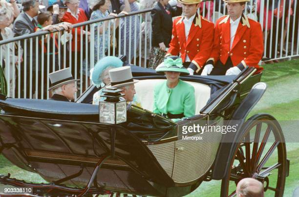 The Princess of Wales Princess Diana in her carriage attends Ascot Surrey She is sitting next to The Queen Mother who is dressed in a blue hat...
