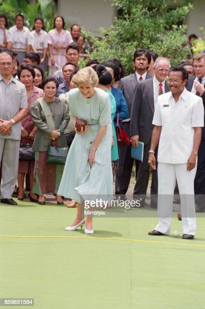 The Princess of Wales Princess Diana playing boules whilst on her Far East Tour of 1989 Here she is on a visit to Sitanala Leprosy Hospital during...