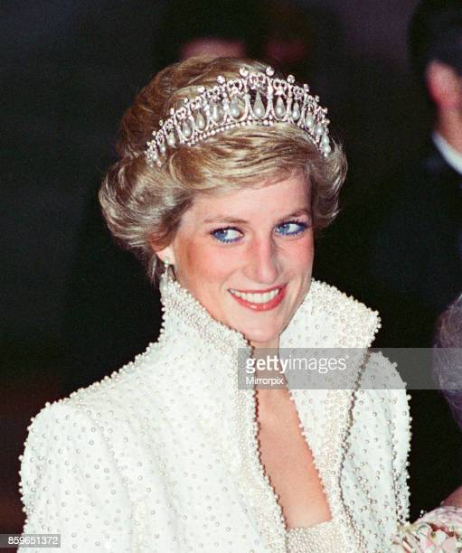 The Princess of Wales Princess Diana visit To Hong Kong as part of their Far East tour Princess Diana wears a diamond coronet and pearls a studded...