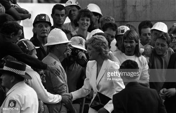 The Princess of Wales shakes hands with construction workers as she visits the Darling Harbour complex in Sydney Australia