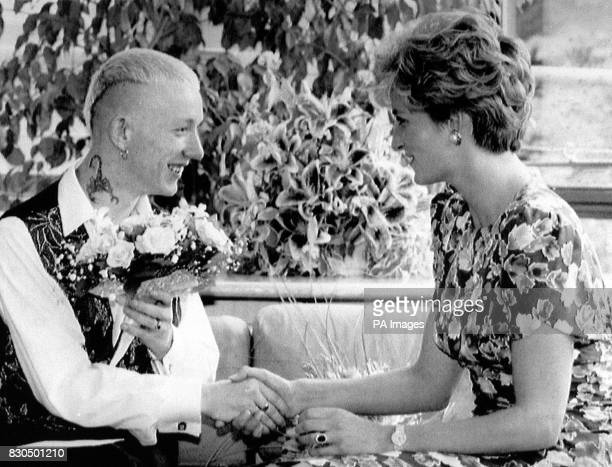 The Princess of Wales shaking hands with William Drake a patient at London Lighthouse Aids Centre * The Prince of Wales toured the Aids charity where...