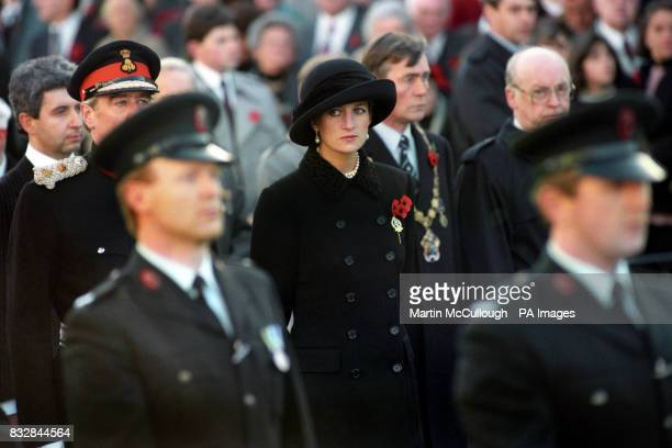 The Princess of Wales stands with solemn expression during the Remembrance Day service that she attended in Enniskillen Northern Ireland Diana was...