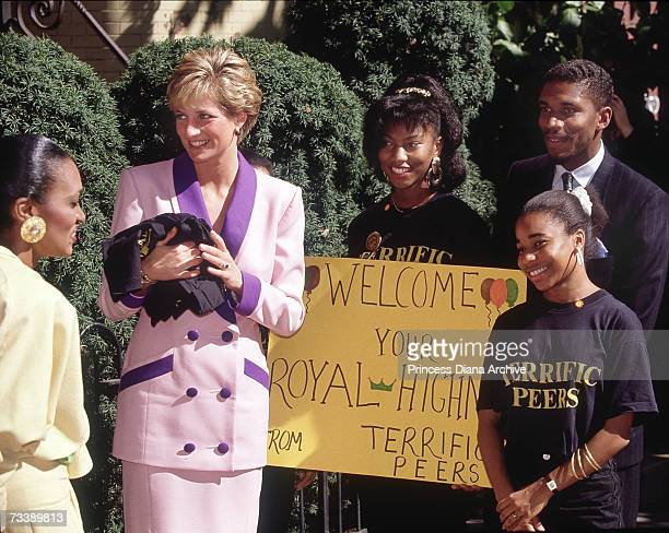 The Princess of Wales visits Grandma's House an HIV centre for children in Washington DC October 1990 She is wearing a pink and purple suit by...