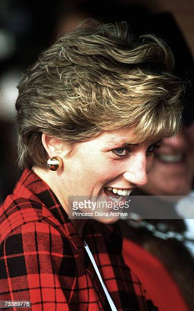The Princess of Wales visits Tenterden Leisure Centre in Kent October 1990 She is wearing a red checked Escada suit