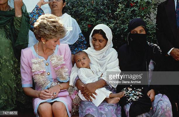 The Princess of Wales visits the Norpoor Family Welfare Centre in Islamabad wearing a Catherine Walker dress 26th September 1991