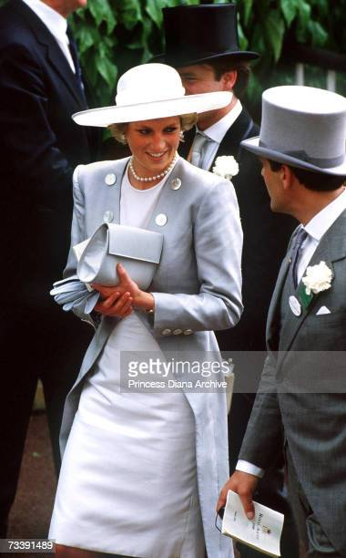 The Princess of Wales, wearing a Catherine Walker suit, at Ascot, June 1988. Her hat is designed by Philip Somerville.