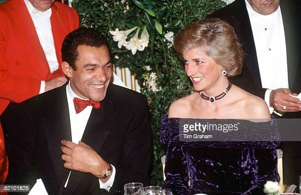 The Princess Of Wales Wearing A Crushed Velvet Purple Evening Dress Designed By Bruce Oldfield Which Featured As Lot No. 73 At The Auction Of Her...
