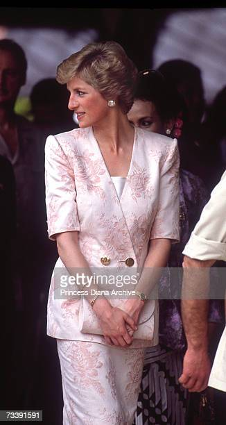 The Princess of Wales wearing a pink Catherine Walker outfit with a matching handbag at the Sultan's palace in Yogyakarta during a visit to Indonesia...