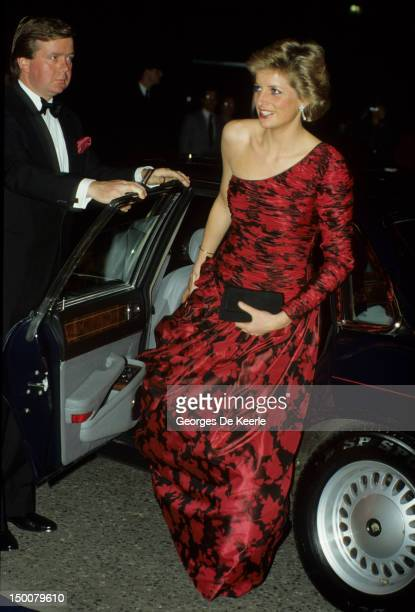 The Princess of Wales, wearing a red and black Catherine Walker evening dress, attends a dinner at the British Embassy in Paris during an official...