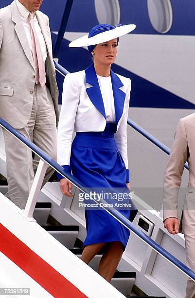 The Princess of Wales wearing a suit by Catherine Walker and Philip Somerville hat arriving in Dubai March 1989