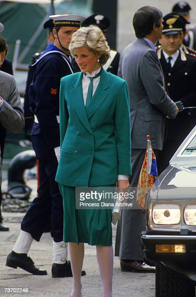 The Princess of Wales wears a green Jasper Conran suit and tie in Livorno during a tour of Italy April 1985