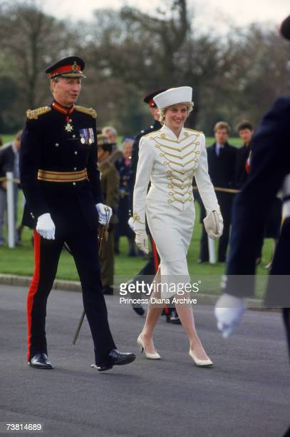 The Princess of Wales wears a suit by Catherine Walker and a hat by Graham Smith of Kangol during a visit to the Royal Military Academy Sandhurst in...