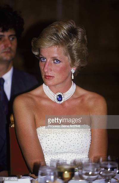 The Princess of Wales wears a white Catherine Walker dress embroidered with pearls to a formal dinner in Budapest 7th May 1990 She accessorises it...