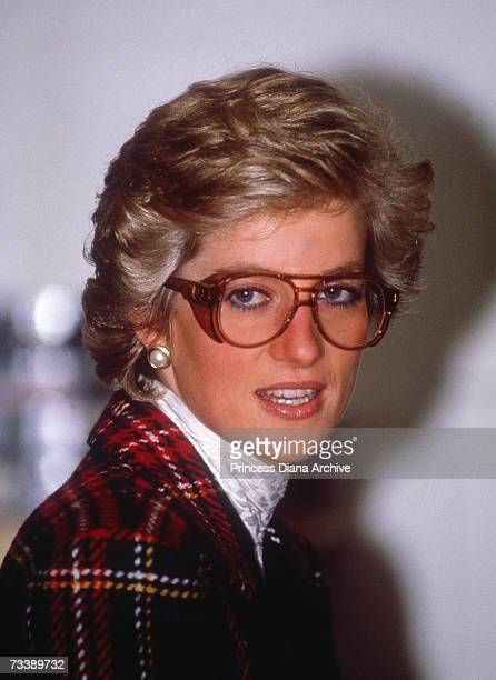 The Princess of Wales wears safety goggles and a Catherine Walker suit during a visit to a laboratory in Ipswich February 1990