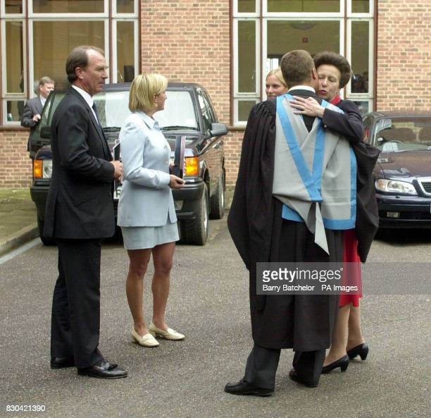 The Princess Royal kisses her son Peter Phillips after his graduation at a ceremony in Exeter University's Great Hall as daughter Zara former husband...