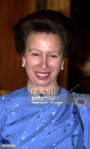 The Princess Royal listens to speeches during a party at Windsor Castle given by the Queen in honour of her 50th birthday and attended by guests from...
