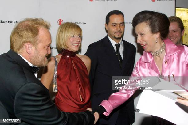 The Princess Royal meets celebrity chief Antony Worrall Thompson as she arrives for the Save The Children Festival of Trees at the Natural History...