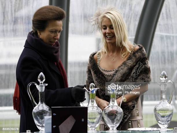 The Princess Royal presents the trophy to Sarah Woodhead the owner of Lady Rangali after winning the Watership Down Stud Sales Stakes on Thoroughbred...