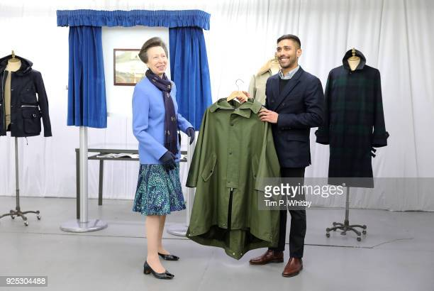The Princess Royal President of the UK Fashion and Textile Association is given a coat by Mo Azam Managing Director of Grenfell on a visit to...