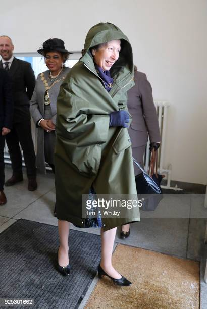 The Princess Royal President of the UK Fashion and Textile Association puts on a coat given to her on a visit to officially open the Grenfell factory...