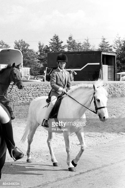 The Princess Royal's nine yearold son Peter Phillips sets off on horseback for his Gatcombe Park home in Gloucestershire after a day at Minchampton...