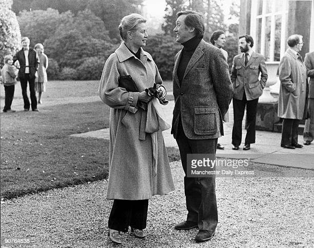 The princess talking to British actor Richard Pasco American film star Grace Kelly starred in �High Noon� �Rear Window� �Dial M for Murder�and �High...
