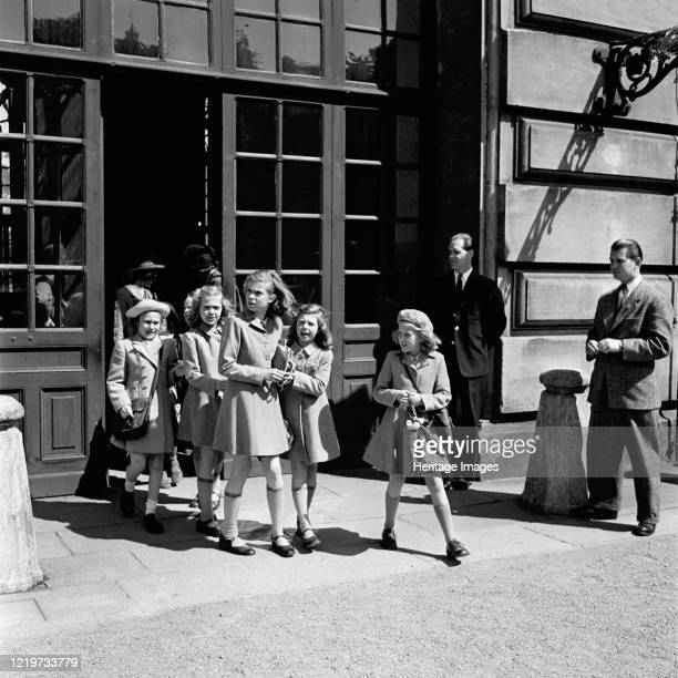The princesses Birgitta Margaretha and Desiree on their way from the Castle School Stockholm Sweden 24/5 1946 Artist Unknown
