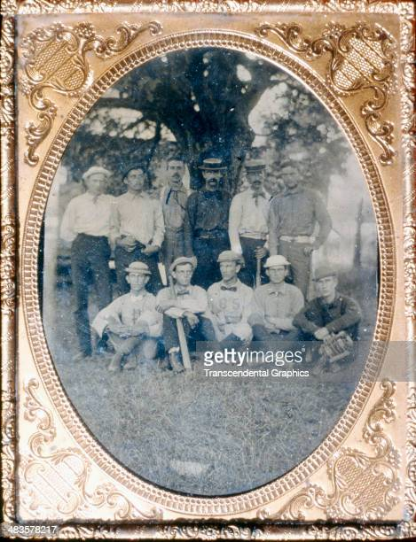 The Princeton baseball team poses under a large tree for a tintype photograph around 1884 in Princeton New Jersey