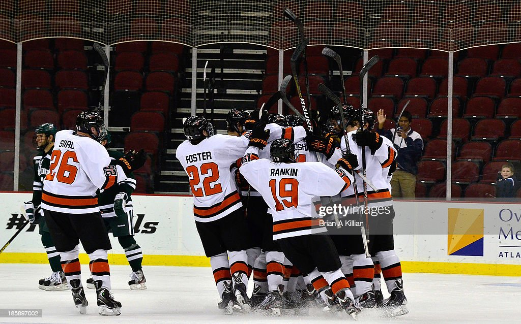 The Princeton Tigers celebrate the game winning goal in overtime against the Dartmouth Big Green at Prudential Center on October 25, 2013 in Newark, New Jersey. The Princeton Tigers won 3-2 in overtime.