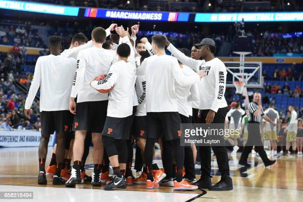 The Princeton Tigers huddle before the First Round of the NCAA Basketball Tournament against the Notre Dame Fighting Irish at The KeyBank Center on...