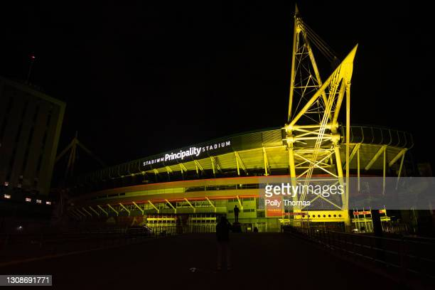 The Principality Stadium lit up yellow during a National Day of Reflection on March 23, 2021 in Cardiff, United Kingdom. Marie Curie Cancer Charity...