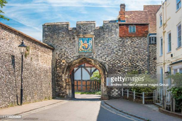 the priory gate is a late 15th-century gate once gave access to courtyard of medieval priory. winchester. hampshire. england. uk. - winchester hampshire stock photos and pictures