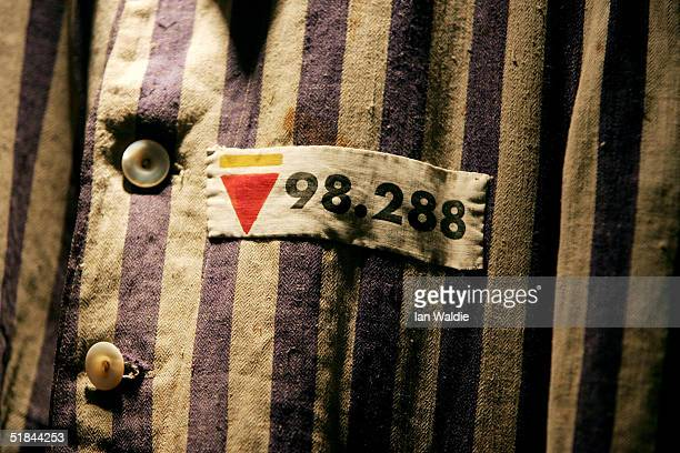 The prison uniform of Auschwitz survivor Mr Leon Greenman, priosoner number 98288 is displayed on December 9, 2004 at the Jewish Museum in London,...