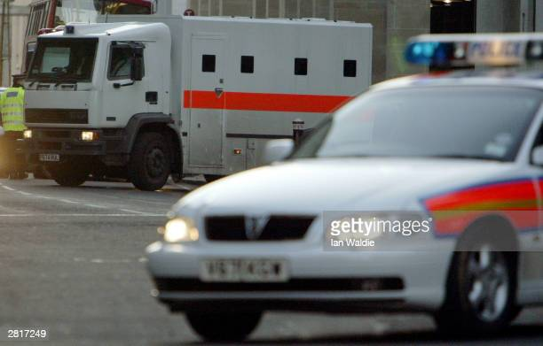 The prison van containing Ian Huntley arrives at the Old Bailey under tight police security on December 17 2003 in London School caretaker Ian...
