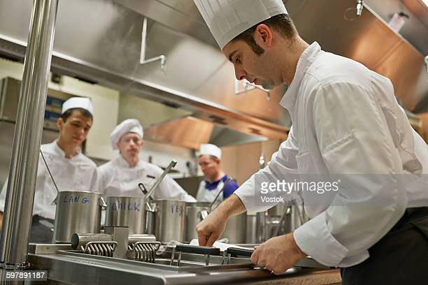 The process of cooking food in restaurant kitchen